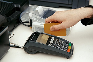cashier swiping a credit card during a sale at a retail store